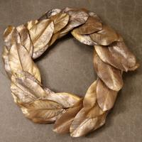 XM11972GO Metallic Magnolia Leaf Wreath Gold 24""